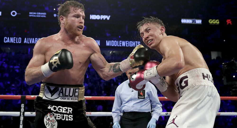 Saul Alvarez (black trunks) lands a punch on the chin of Gennady Golovkin during Saturday's fight in Las Vegas