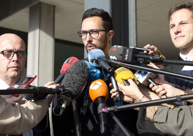 Spanish rapper Jose Miguel Arenas Beltran, also known as Valtonyc, center, speaks with the media with his two lawyers, Gonzalo Boye, left, and Simon Bekaert, right, as he leaves the courthouse in Ghent, Belgium, Monday, Sept. 17, 2018