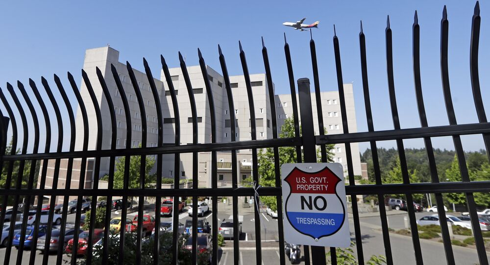The Federal Detention Center where Blanca Orantes-Lopez is held some 3,000 miles away from her child is seen behind a fence as a jet flies overhead Tuesday, June 19, 2018, in SeaTac, Wash
