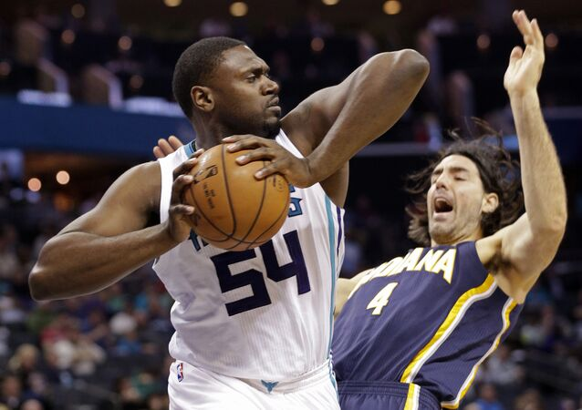 Charlotte Hornets' Jason Maxiell (54) grabs a rebound over Indiana Pacers' Luis Scola (4) during the first half of an NBA basketball game in Charlotte, N.C., Sunday, Feb. 8, 2015