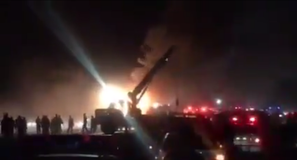 A bus and an oil tanker collided in Iran