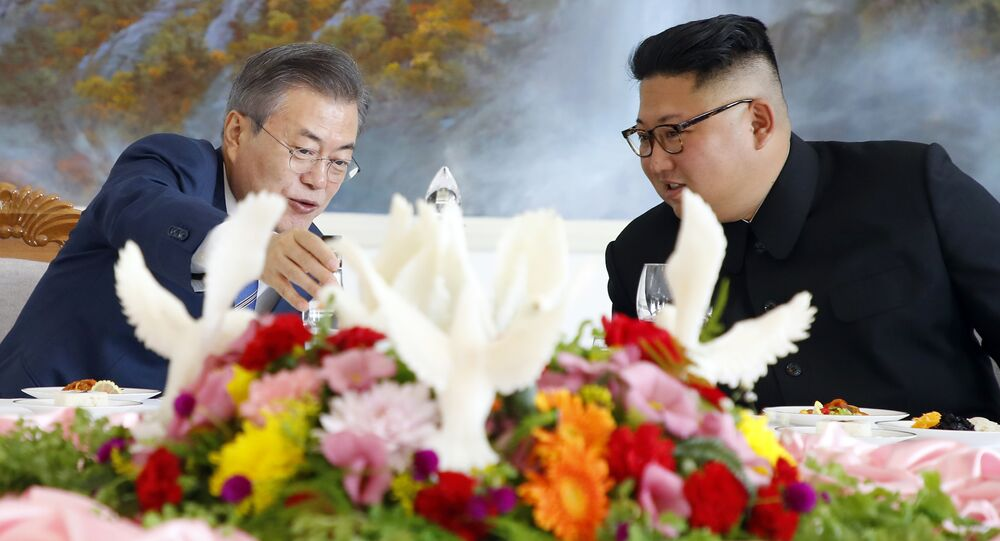 South Korean President Moon Jae-in, left, talks with North Korean leader Kim Jong Un at Okryu-Gwan restaurant in Pyongyang, North Korea, Wednesday, Sept. 19, 2018