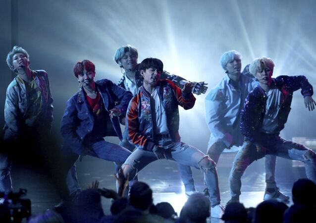BTS performs DNA at the American Music Awards at the Microsoft Theater on Sunday, Nov. 19, 2017, in Los Angeles