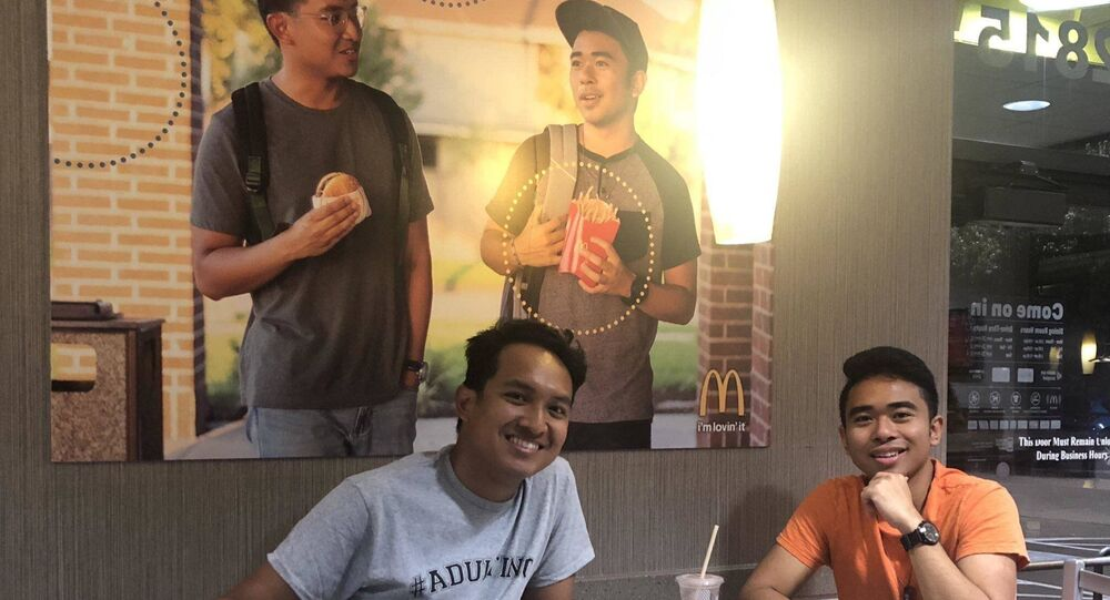 Two friends wanted to see more Asian representation in McDonald's ads. So, they hung up a photo of themselves in a Texas restaurant.
