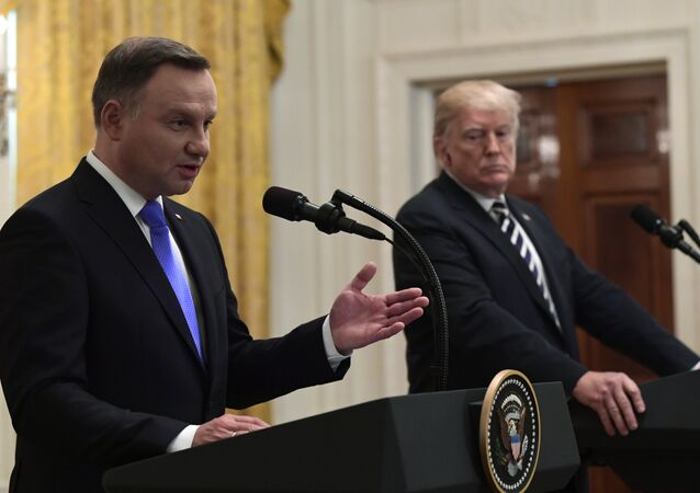 President Donald Trump, right, listens as Polish President Andrzej Duda, left, speaks during a joint news conference in the East Room of the White House in Washington, Tuesday, Sept. 18, 2018