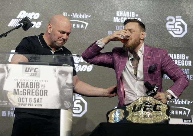 Conor McGregor, right, and UFC president Dana White have a drink during a news conference in New York, Thursday, Sept. 20, 2018. McGregor is returning to UFC after a two-year absence