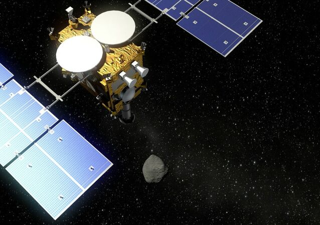 The Hayabusa 2 probe and an asteroid - visualization