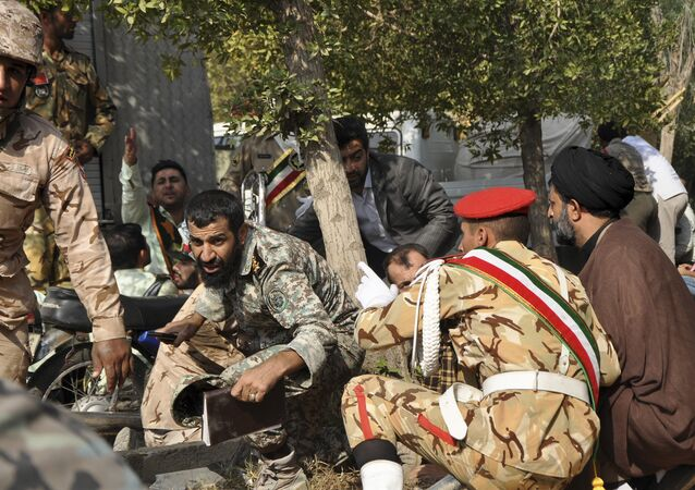 Iranian armed forces members and civilians take shelter in a shooting during a military parade marking the 38th anniversary of Iraq's 1980 invasion of Iran