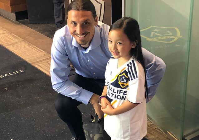 Zlatan Ibrahimovic poses with singer Malea Emma
