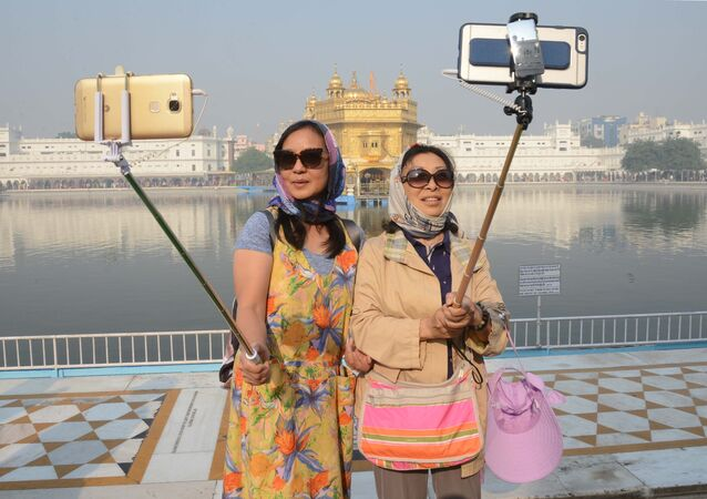 Chinese tourists take a 'selfie' at the Golden Temple in Amritsar (File)