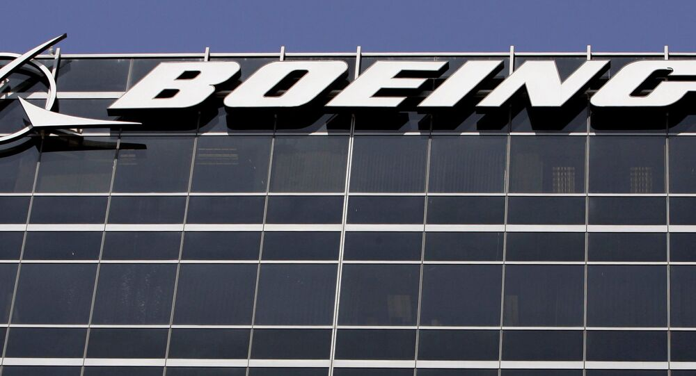 File-In this Wednesday, May 21,2008 file photo, the company logo for The Boeing Co., is displayed in El Segundo, Calif. Boeing Co. say it's cutting 1,100 jobs from its U.S. plants, most of them in Southern California, as it scales back production of its C-17 cargo planes.