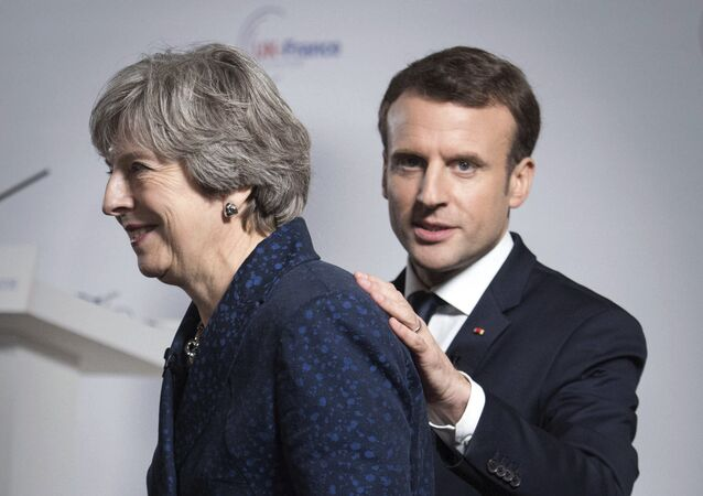 Britain's Prime Minister Theresa May and French President Emmanuel Macron during a media conference at the Royal Military Academy Sandhurst, in Camberley, England, after UK-France summit talks, Thursday Jan. 18, 2018.