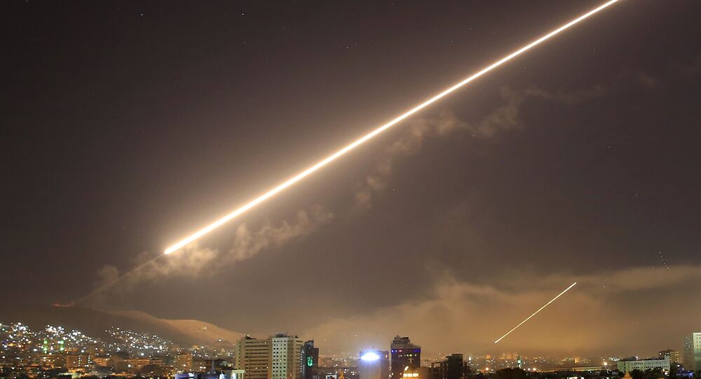 In this 14 April 2018 file photo, the skies above Damascus erupt with surface to air missile fire as the US launches an attack on Syria, targeting different parts of the capital Damascus
