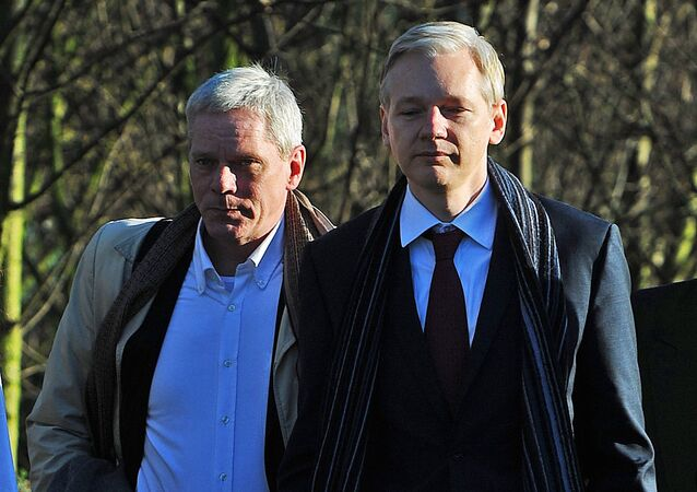 WikiLeaks founder Julian Assange (R) arrives with WikiLeaks spokesman Kristinn Hrafnsson at Belmarsh Magistrates' Court, in south-east London, on February 8, 2011