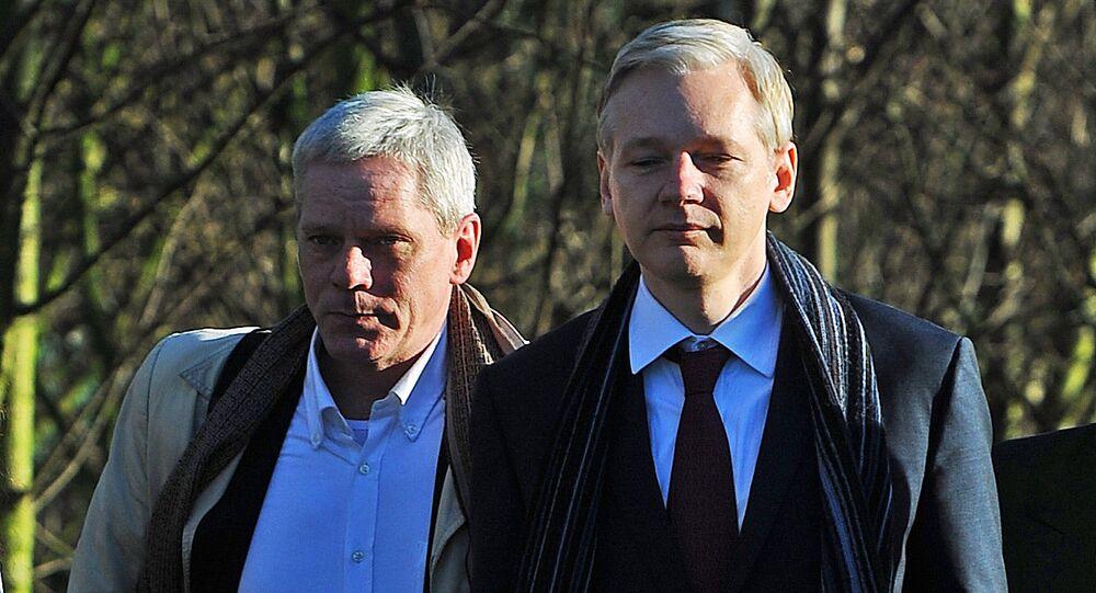 WikiLeaks founder Julian Assange (R) arrives with WikiLeaks spokesman Kristinn Hrafnsson at Belmarsh Magistrates' Court, in south-east London, on February 8, 2011