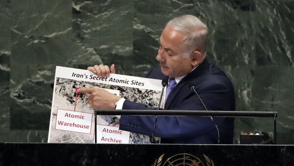 Israel's Prime Minister Benjamin Netanyahu shows an atomic warehouse in Teheran during his address the 73rd session of the United Nations General Assembly, at U.N. headquarters, Thursday, Sept. 27, 2018 - Sputnik International