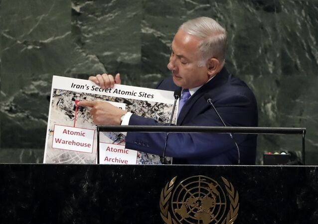 Israel's Prime Minister Benjamin Netanyahu shows an atomic warehouse in Teheran during his address the 73rd session of the United Nations General Assembly, at U.N. headquarters, Thursday, Sept. 27, 2018