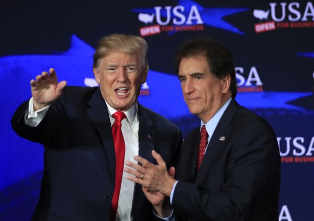 President Donald Trump with Rep. Jim Renacci, R-Ohio, right, waves during a roundtable discussion on tax cuts at Cleveland Public Auditorium and Conference Center in Cleveland, Ohio, Saturday, May 5, 2018.