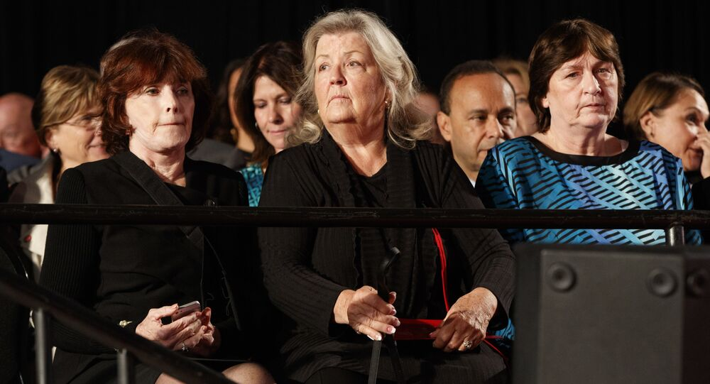 Kathy Shelton, right, Juanita Broaddrick, center, and Kathleen Willey arrive for the second presidential debate between Republican presidential candidate Donald Trump and Democratic presidential candidate Hillary Clinton at Washington University, Sunday, Oct. 9, 2016, in St. Louis.