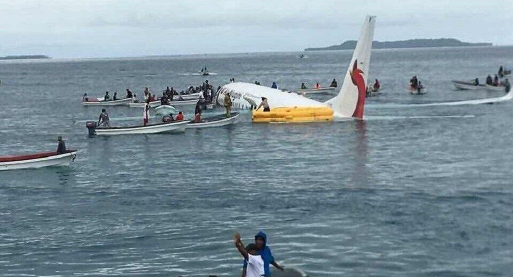 A plane heading toward  Papua New Guinea lands in ocean after overshooting a runway in Micronesia