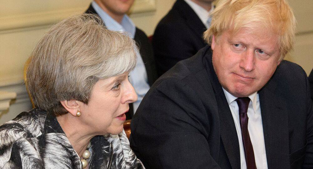 Britain's Prime Minister Theresa May sits next to Britain's Foreign Secretary Boris Johnson as she holds the first Cabinet meeting following the general election at 10 Downing Street, in London June 12, 2017