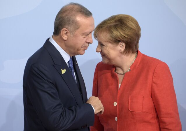 Turkish President Recep Tayyip Erdogan, left, is welcomed by German Chancellor Angela Merkel on the first day of the G-20 summit in Hamburg, northern Germany, Friday, July 7, 2017