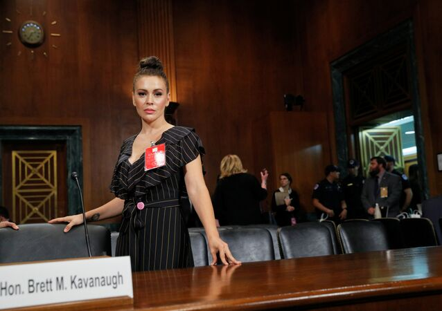 Actor Alyssa Milano stands in the hearing room after the conclusion of testimony before a Senate Judiciary Committee confirmation hearing for Kavanaugh by Professor Christine Blasey Ford, who has accused U.S. Supreme Court nominee Brett Kavanaugh of a sexual assault in 1982, on Capitol Hill in Washington, U.S., September 27, 2018
