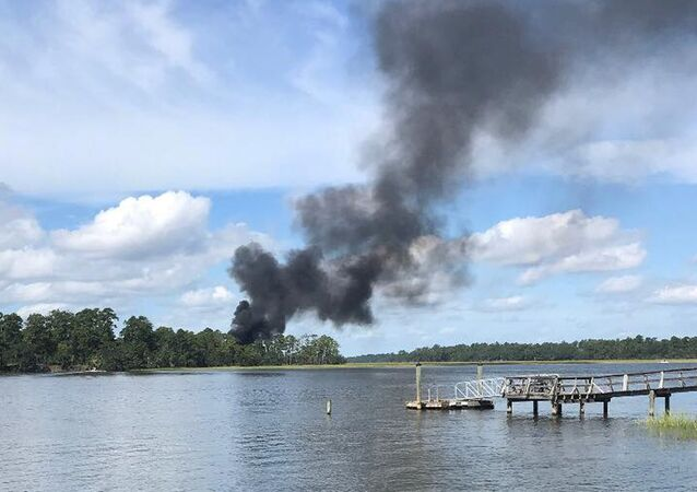 Smoke rises at the site of a F-35 jet crash in Beaufort, South Carolina, U.S., September 28, 2018 in this still image obtained from social media