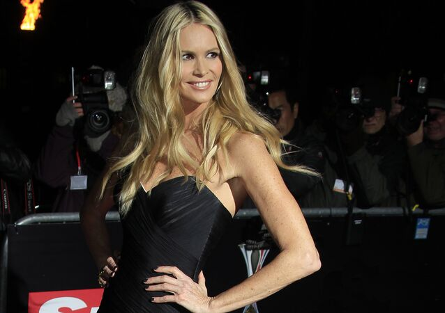 Elle Macpherson arrives on the red carpet for the Sun Military Awards at the Imperial War Museum, Thursday, Dec. 6, 2012. The Millies, saluting the bravery of Britain's Armed Forces, are in their fifth year