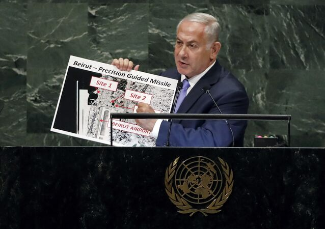 Israel's Prime Minister Benjamin Netanyahu shows guided missile sites in Beirut during his address of the 73rd session of the United Nations General Assembly, at U.N. headquarters, Thursday, Sept. 27, 2018