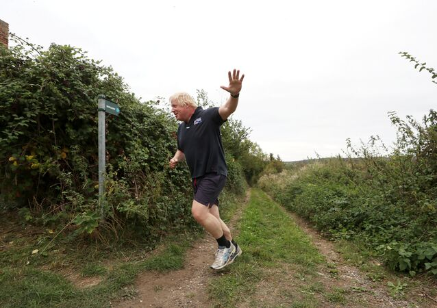 Britain's former Foreign Secretary Boris Johnson jogs near his home in Oxfordshire, September 11, 2018
