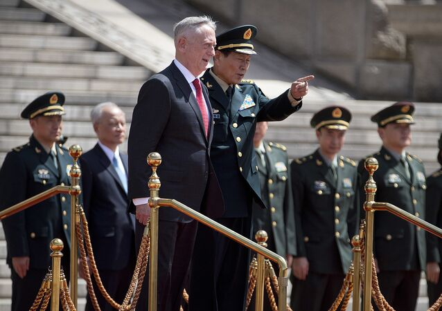 U.S. Defense Secretary Jim Mattis, center left, and China's Defense Minister Wei Fenghe stand together during a welcome ceremony at the Bayi Building in Beijing, Wednesday, June 27, 2018