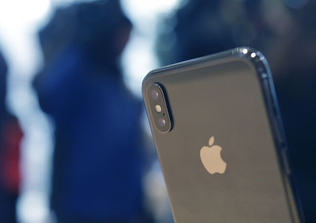 The Apple iPhone X sits on display at the new Apple Michigan Avenue store along the Chicago River Friday, Nov. 3, 2017, in Chicago.