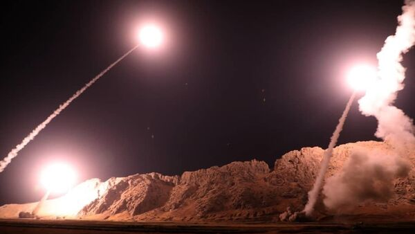 In this photo released on Monday, Oct. 1, 2018, by the Iranian Revolutionary Guard, missiles are fired from city of Kermanshah in western Iran targeting the Islamic State group in Syria. - Sputnik International