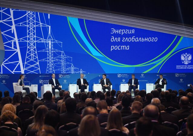 From left: TV presenter of Rossiya 24 channel Evelina Zakamskaya, CEO of Rosseti Pavel Livinsky, Moscow Mayor Sergei Sobyanin, Energy Minister Alexander Novak, President and CEO of Sberbank Herman Gref and Schneider Electric Executive Vice President for Industry Peter Herweck at the Russian Energy Week 2017 International Forum in Moscow