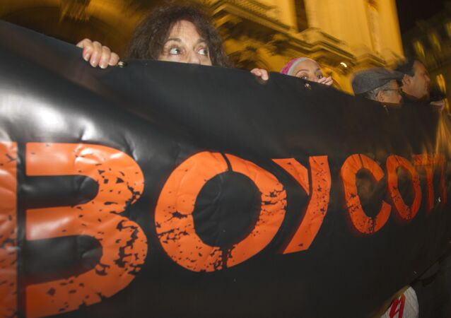 French demonstrators and supporters of Palestinians hold a placard with the word Boycott during a demonstration in Paris, France (File)