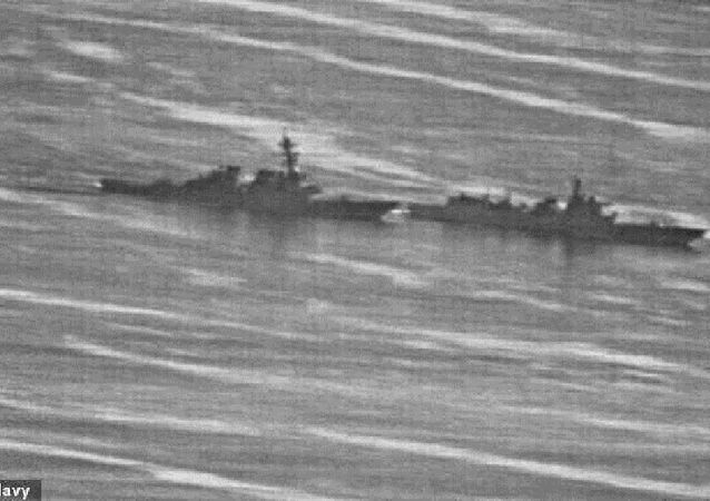 The USS Decatur (left) swerved to avoid the Chinese warship, PRC 170 (right) in the South China Sea on September 30