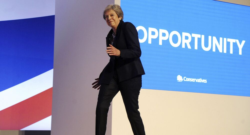 Conservative Party Leader and Prime Minister Theresa May dances as she arrives on stage to address delegates during a speech at the Conservative Party Conference at the ICC, in Birmingham, England, Wednesday, Oct. 3 , 2018.