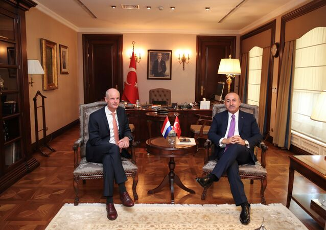 Turkish Foreign Minister Mevlut Cavusoglu and his Dutch counterpart Stephanus Blok pose at the begining of a meeting in Ankara, Turkey, October 3, 2018