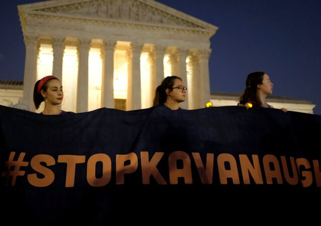CORRECTING YEAR Activists gather outside the U.S. Supreme Court to hold a vigil in opposition to U.S. Supreme Court nominee Brett Kavanaugh in Washington, U.S., October 3, 2018