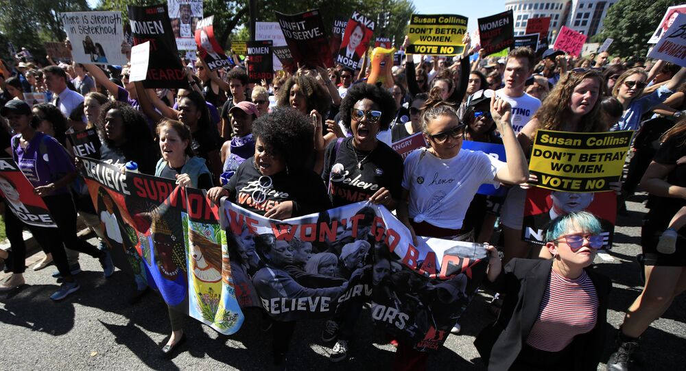 Protesters against Supreme Court nominee Brett Kavanaugh march towards the Supreme Court in Washington, Thursday, Oct. 4, 2018.