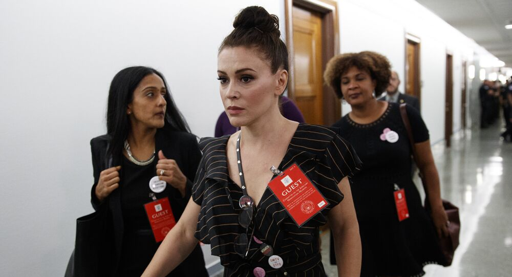 Actress Alyssa Milano walks to a Senate Judiciary Committee hearing after a break on Capitol Hill in Washington, Thursday, Sept. 27, 2018, with Christine Blasey Ford and Supreme Court nominee Brett Kavanaugh