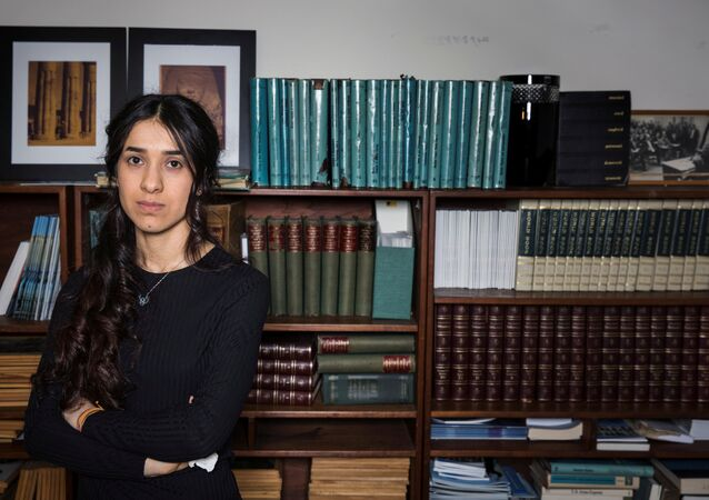 Yazidi survivor Nadia Murad poses for a portrait at United Nations headquarters in New York, U.S., March 9, 2017