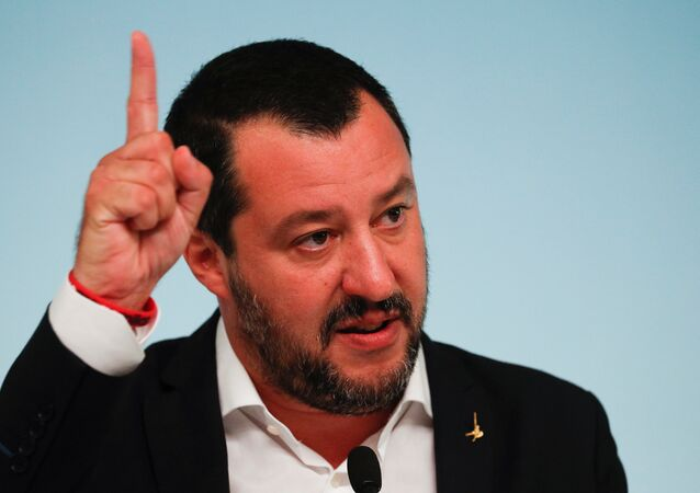 Italy's Interior Minister Matteo Salvini gestures during a news conference with Prime Minister Giuseppe Conte after to approve a new decree of the measures on immigration and security at Chigi Palace in Rome, Italy, September 24, 2018