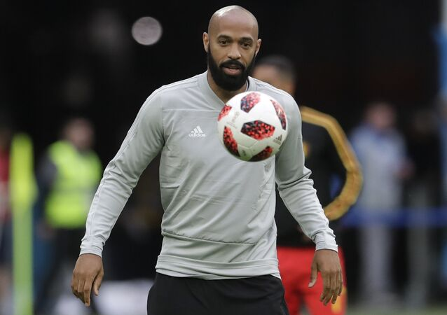 Belgium assistant coach Thierry Henry eyes the ball prior to the semifinal match between France and Belgium at the 2018 soccer World Cup in the St. Petersburg Stadium, in St. Petersburg, Russia, Tuesday, July 10, 2018