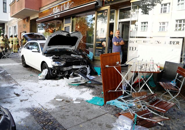 Firefighters look at damage after a man drove a car into a cafe in the Charlottenburg district of Berlin, Germany, October 5, 2018, injuring several people