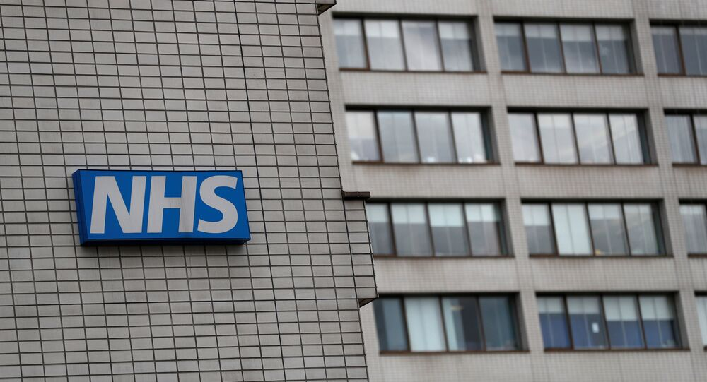 FILE PHOTO: An NHS sign is seen at St Thomas' Hospital in central London, Britain May 12, 2017