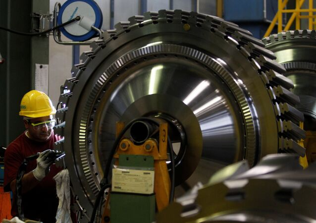An employee of Siemens AG works on the a gas turbine in Berlin (File)