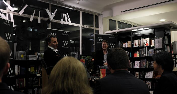 A grinning Luke Harding and Mark Urban in conversation
