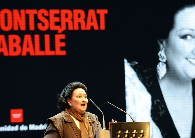 Spanish Catalan opera soprano Montserrat Caballe speaks after being awarded the International medal for Arts on November 18, 2013 in Madrid during the culture prize giving ceremony in the Red Room of the town hall in Madrid.
